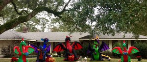 Five dragon decorations sit on the front lawn of a Louisiana home.
