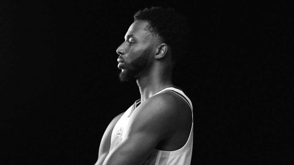 A black-and-white photo of Andrew Wiggins in profile