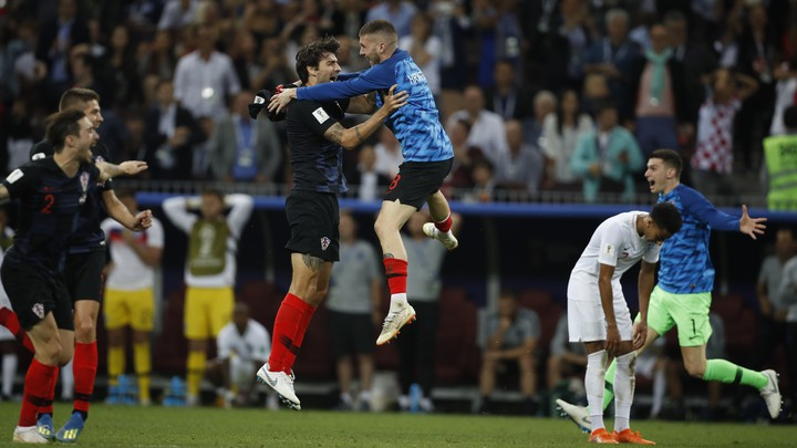 Players from the Croatia team celebrate after the semifinal match between Croatia and England at the 2018 soccer World Cup