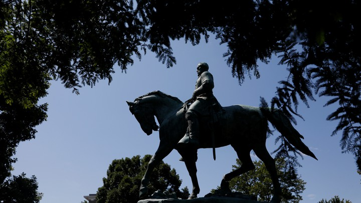 The statue of Confederate General Robert E. Lee sits at the center of the park formerly dedicated to him, the site of recent violent demonstrations in Charlottesville, Virginia.