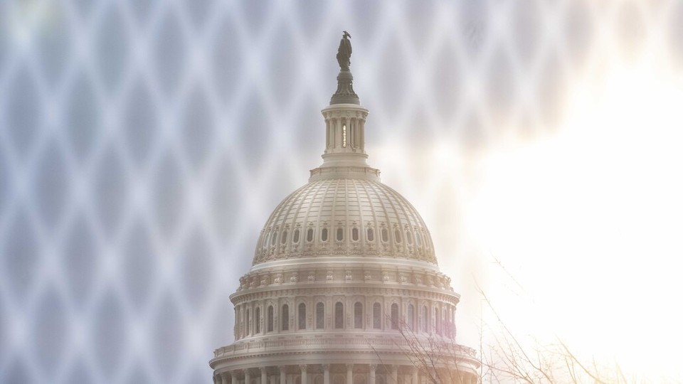 The U.S. Capitol behind a fence.