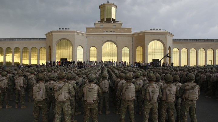 Georgian soldiers attend a farewell ceremony in Tbilisi before leaving for Afghanistan in 2013.