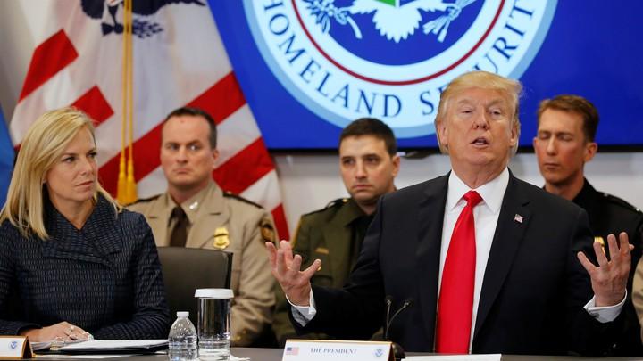 Donald Trump and Homeland Security Secretary Kirstjen Nielsen speak at a meeting in February.
