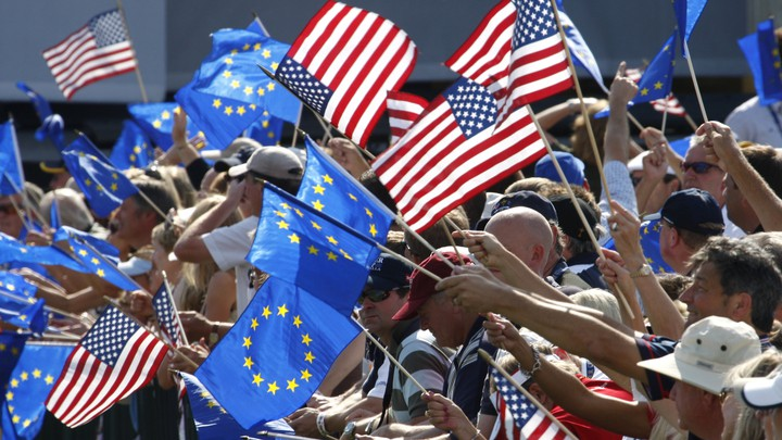 Spectators wave American and European Union flags at a golf tournament in 2008.
