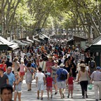 Pedestrians stroll down Las Ramblas in Barcelona in 2015.