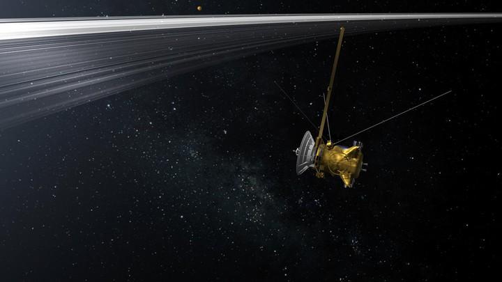 An illustration of the Cassini spacecraft cruising through space