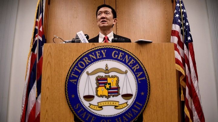 Hawaii Attorney General Douglas Chin speaks at a press conference after filing an amended lawsuit against Donald Trump's travel ban on March 9, 2017.