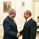 Netanyahu and Putin shake hands at a meeting at the Kremlin in July.