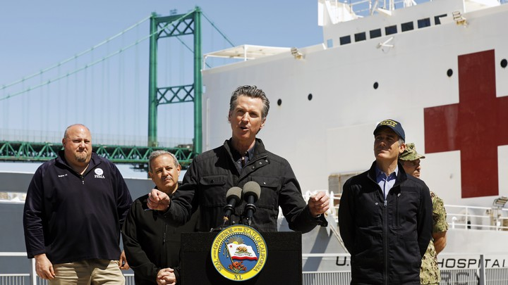 California Governor Gavin Newsom speaks in front of the hospital ship USNS Mercy that arrived into the Port of Los Angeles.