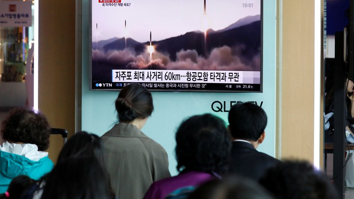 People at a railway station in Seoul, South Korea, watch a TV news report about North Korea's missile launch in April 2017.