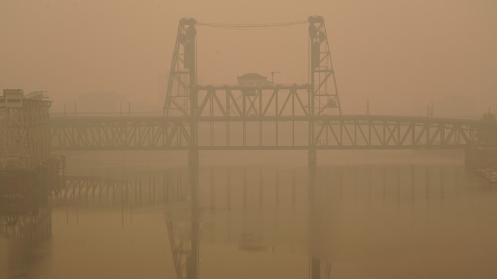 The Portland Steel Bridge covered in smoke from wildfires.