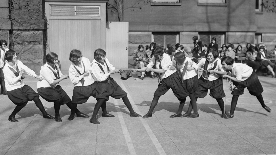 A group of students playing tug-of-war