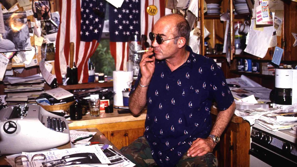 """Hunter Thompson The """" Gonzo """" Journalist Sits At His Desk In His Rocky Mountain Cabin."""