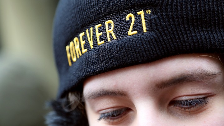 A person wearing a black Forever 21 hat