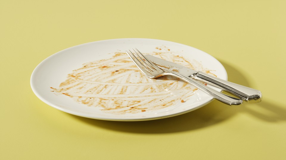 A dirty, empty dinner plate