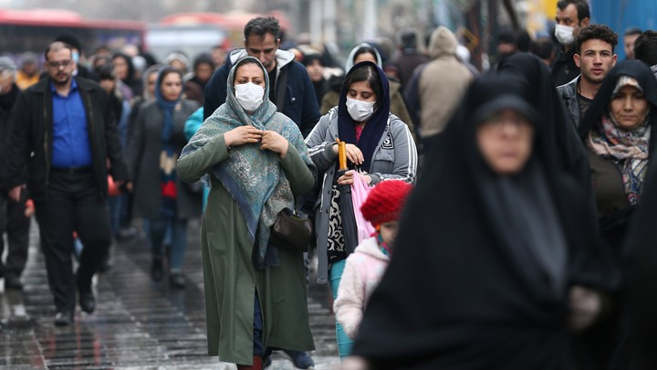 People in Iran wearing face masks
