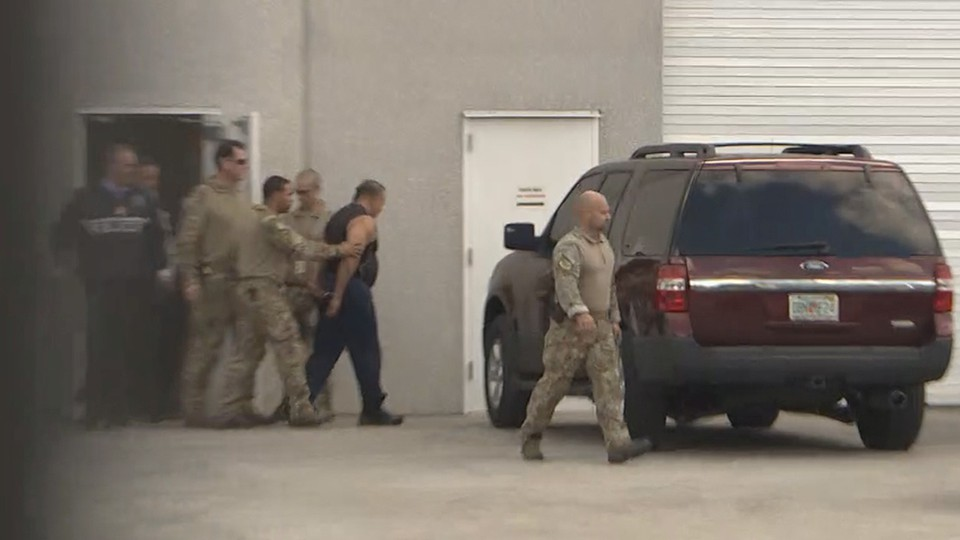 FBI officers escort Cesar Sayoc to a waiting SUV after his arrest in Miramar, Florida, on October 26.