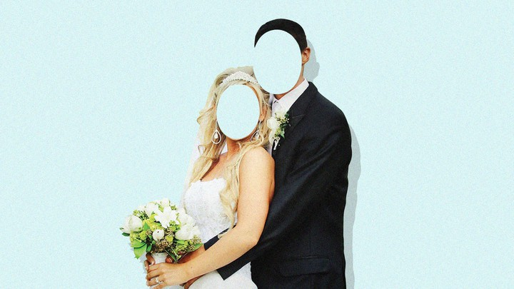 A picture of a bride and groom with their faces missing