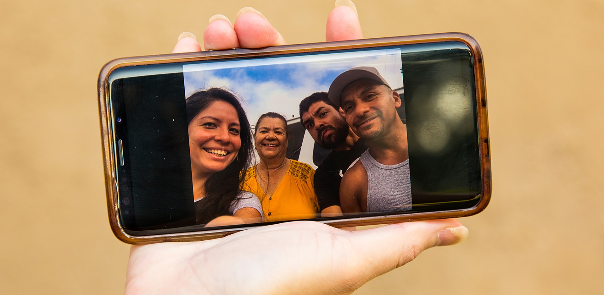 Photo of Christian Zuniga and family on Diana's phone
