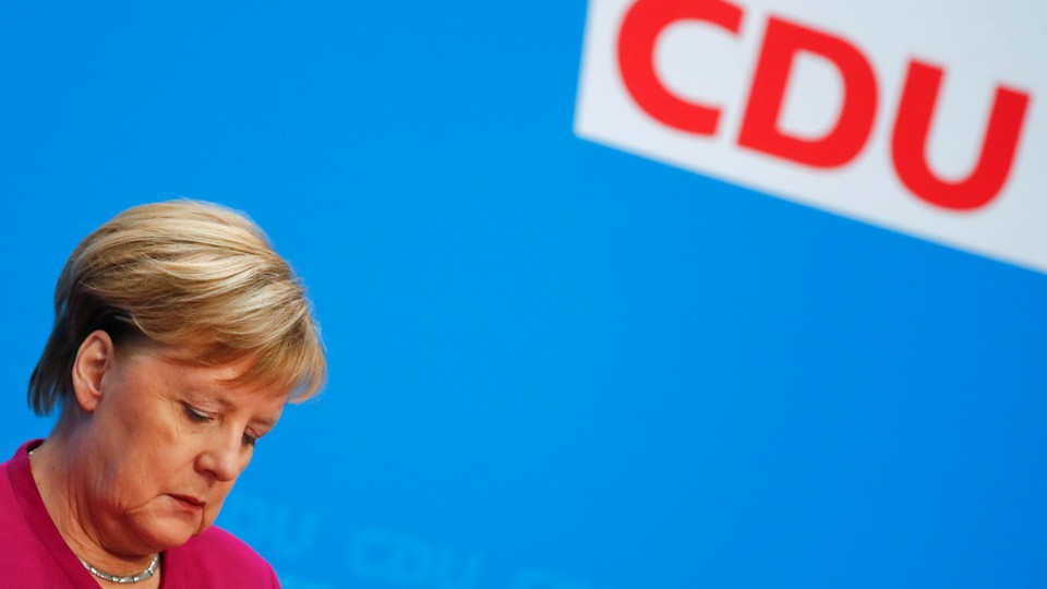 Angela Merkel attends a news conference after learning the results of the election in Hesse, Germany.
