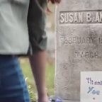 A girl stoops to leave a hand-written thank-you note at Susan B. Anthony's grave.