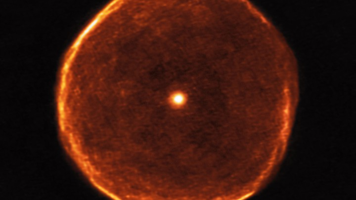 A large glowing red star that appears to have a red bubble around it