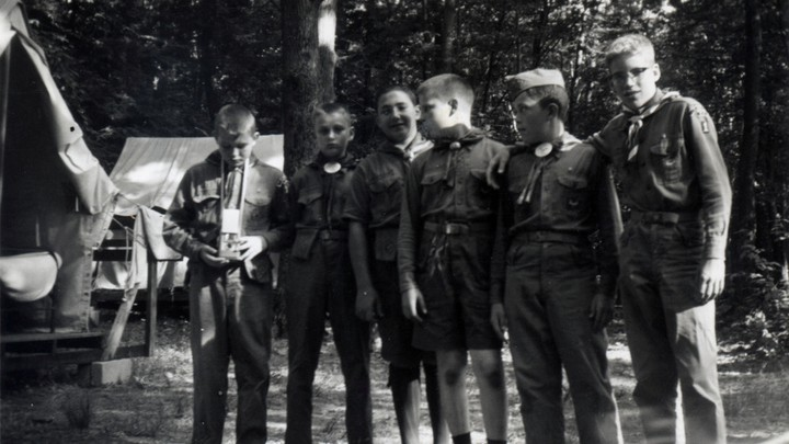 Boy Scouts stand together in a line.