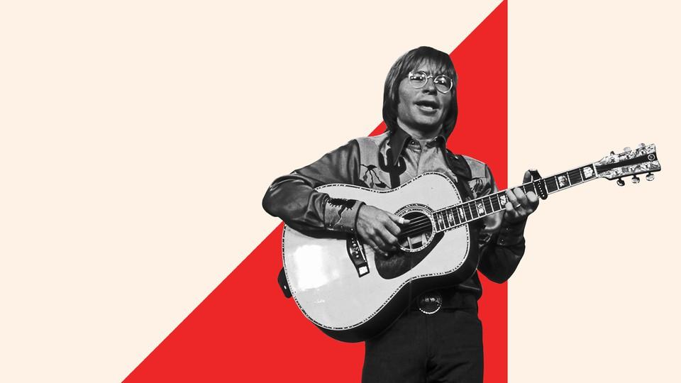 John Denver playing the guitar