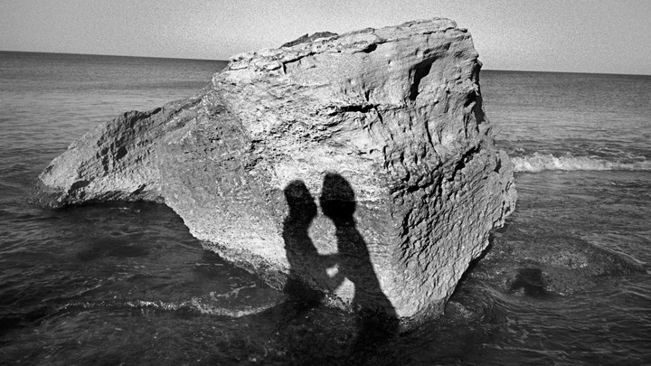 Shadow of a couple at the beach