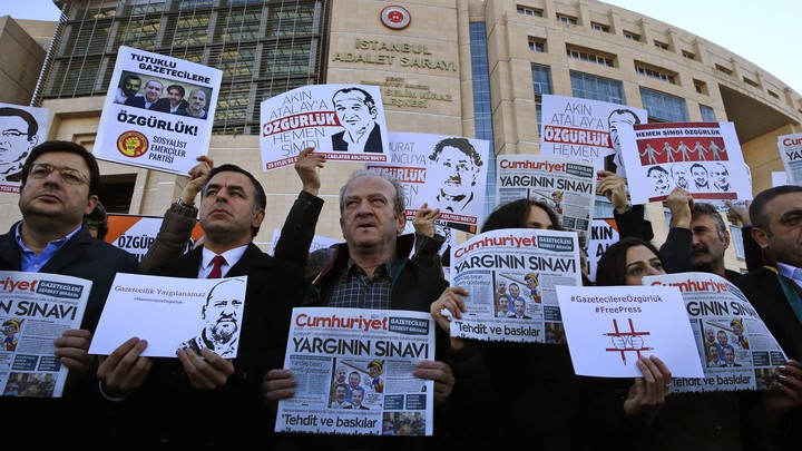 Demonstrators hold copies of Cumhuriyet outside the court where several of the newspaper's employees were on trial in 2017.