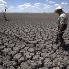 A Texas State Park police officer walks on the cracked and drought-wracked lakebed of O.C. Fisher Lake, in San Angelos, Texas