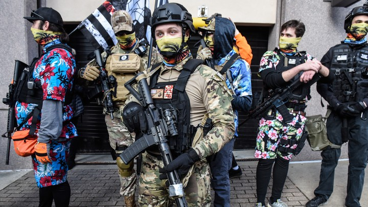 Members of a pro-gun group called the Last Sons of Liberty stand with their weapons near the state Capitol on January 18, 2021 in Richmond, Virginia. Capitol Square in Richmond has been closed until January 21, in anticipation of possible unrest after the riots at the U.S. Capitol on January 6th.