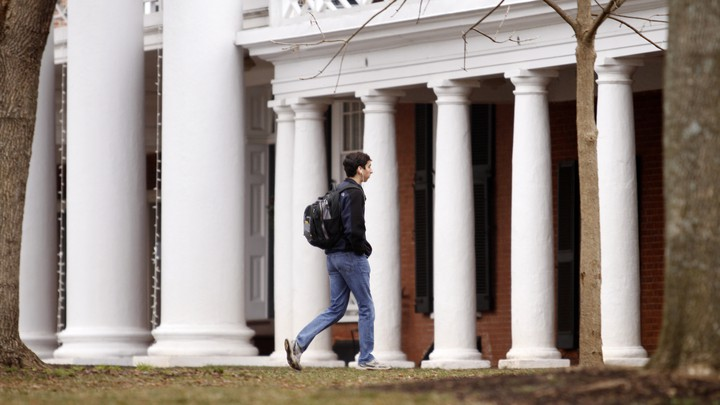 a student walks on campus