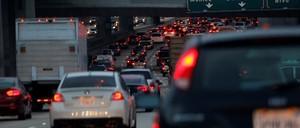 Cars jam an early-morning freeway in California.