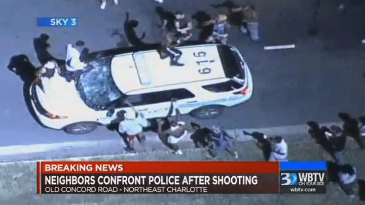 A police vehicle is damaged after protests broke out Tuesday in Charlotte, NorthCarolina, following a fatal shooting of a black man by police.