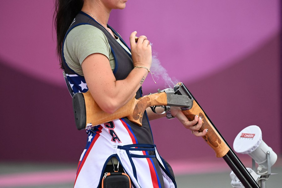 A shooter removes spent shells during an event.