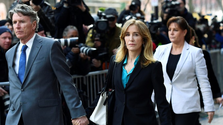 Felicity Huffman leaves a federal courthouse on April 3, 2019.