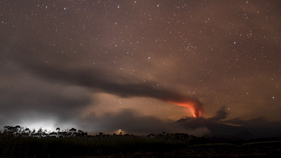 Mount Raung, a volcano in Indonesia, erupts at night.