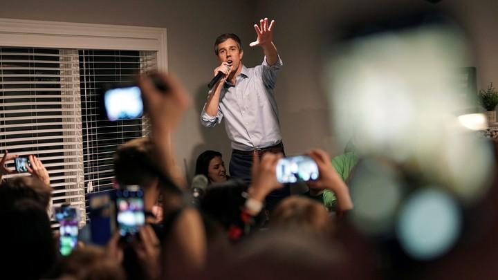 Beto O'Rourke speaks with a supporter in Iowa.