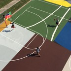 Men play basketball on a redesigned court in Kinloch Park, Missouri.