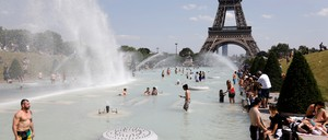 a photo of Parisians cooling off in the fountains of the Trocadero Gardens earlier this week