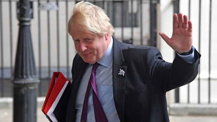 Now-former British Foreign Secretary Boris Johnson waves as he leaves Downing Street on June 28, 2018.