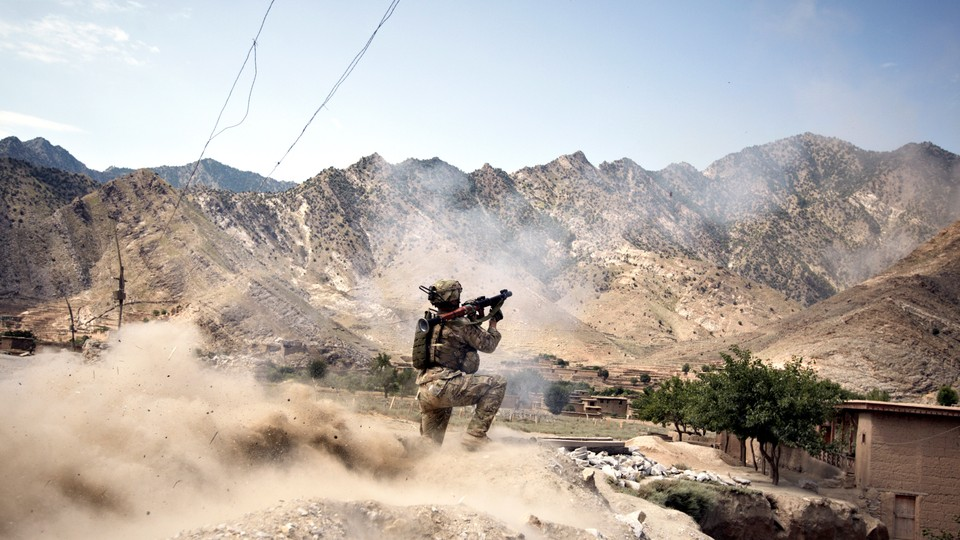 In Kunar Province's volatile Pech River Valley, a U.S. Army soldier fires a rocket-propelled grenade during a firefight with Taliban insurgents.