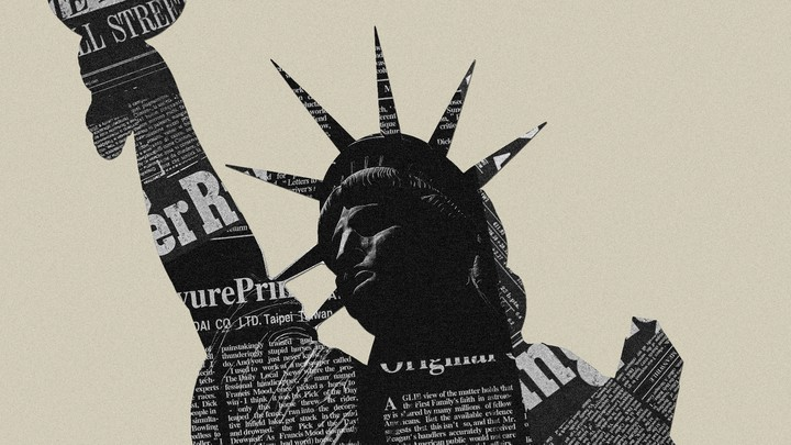 Picture of newspaper on top of the Statue of Liberty