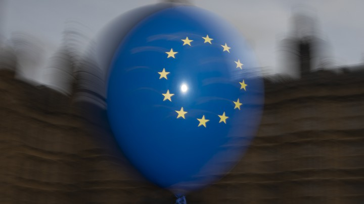 EU balloons are waved by anti Brexit campaigners outside the Houses of Parliament in London.