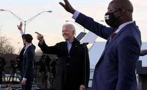 Jon Ossoff, Joe Biden, and Raphael Warnock campaign on a stage in Georgia.