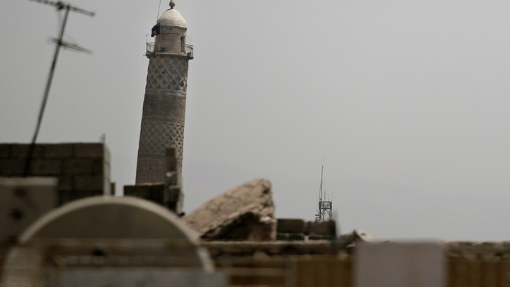 An ISIS flag hangs from Mosul's Al-Habda minaret at the Grand Mosque of al-Nuri in western Mosul on May 29, 2017.