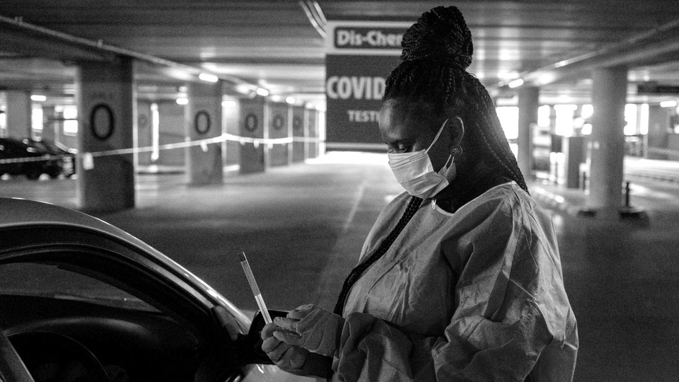 A health worker testing a driver