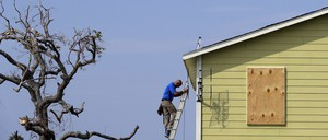 A worker repairs a Texas home after Hurricane Harvey in September 2017.