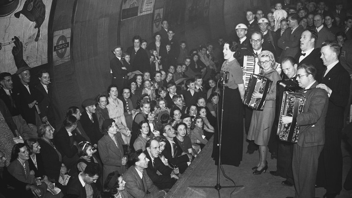 Londoners shelter and listen to music during the German bombings of World War II.